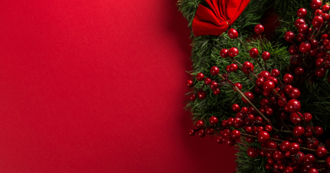 red background with holiday wreath