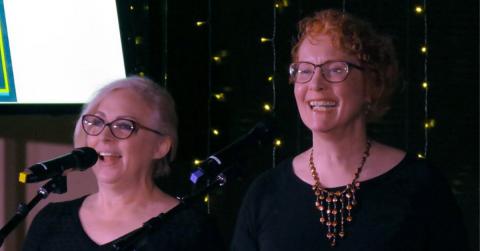 Pam Kilmer and Lee-Ann Williams singing